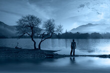 Man Silhouette Near A Lake Derwentwater Keswick Lake District  Cumbria England UK Europe