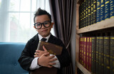 Little boys in suit looking and choose book