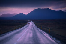 Drive Car On Road. Iceland Travel. Beautiful Nature Icelandic Landscape In Pink Sunset