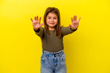 Little Caucasian Girl Isolated On Yellow Background Celebrating A Victory Or Success, He Is Surprised And Shocked.