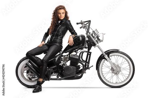 Papel de parede Young woman sitting on a chopper motorbike