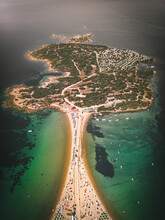 Aerial View Of Isuledda, A Small Island With Many Boats Sailing The Turquoise Mediterranean Sea Water, Sardinia, Italy.