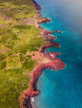 Aerial View Of Wild Coastline On Pico Island, View Of Green Vegetation With Cliffs Facing The Atlantic Ocean Blue Waters, Azores Archipelagos, Portugal.