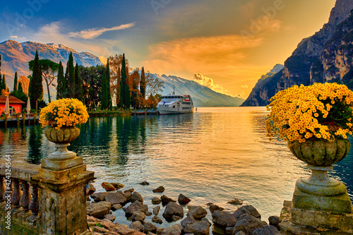 Fotografie, Obraz View of the beautiful Lake Garda surrounded by mountains, Scenic view of sunset