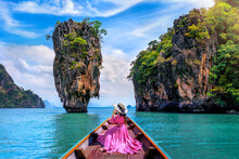 Beautiful Girl Sitting On The Boat And Looking To James Bond Island In Phang Nga, Thailand.