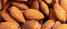 Close Up Of Almond Nuts As Background.