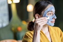 Woman Applying Bubble Cleansing Mask