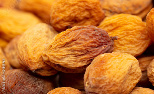 Obraz na plátne Dried apricots as an abstract background.