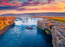Aerial Landscape Photography. Colorful Summer View From Flying Drone Of Skjalfandafljot River, Iceland, Europe. Sunrise On Godafoss, Spectacular Waterfall Plunging Over A Curved, 12m-high Precipice.
