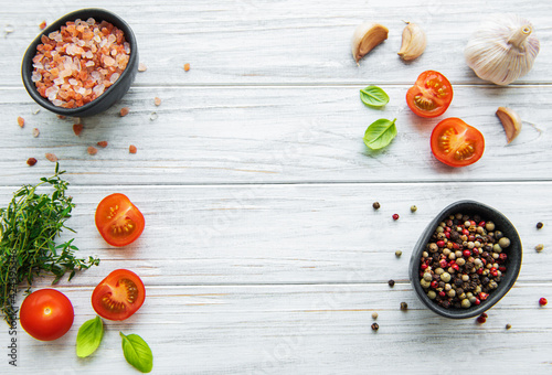 Tomato, basil and pepper with garlic on white wooden background Wallpaper Mural
