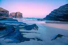 Seascape In The Morning. Rocky Sea Coast At Sunrise. Beach Playa De Las Catedrales In Ribadeo, Galicia, Spain, Europe