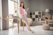 Full Length Body Size Profile Side View Of Lovely Cheerful Pregnant Girl Staying Safe Using Gadget Blogging App 5g In Flat House Indoors
