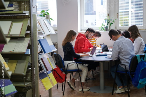 Obraz students group working on school project together on tablet computer at modern university - fototapety do salonu