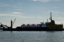 HOPPER DREDGER - Specialized Ship And LNG Carrier In The Background