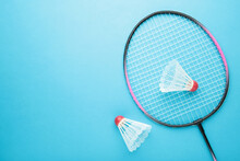 Shuttlecocks And Badminton Racket On Blue Background. Badminton Equipment