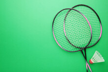 Shuttlecock And Badminton Rackets On Green Background. Badminton Equipment