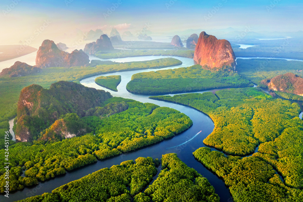 Fototapeta Aerial view of Phang Nga bay with mountains at sunrise in Thailand.