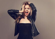 Beautiful Funny Happy Young Blond Woman In Boredom Holding The Head The Hands In Fashion Black Leather Jacket. Closeup