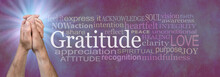 Words Associated With Gratitude Prayer - Male Hands Clasped In Prayer Position Beside A GRATITUDE Word Cloud Against A Rustic Textured Purple Background With A Bright Blue Light Burst Behind Hands