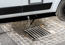 Close Up View Of Proper Disposal Of Gray Water And Waste Water From A Camper Van At An RV Park