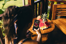 Unrecognizable Woman Taking Photo Of Tropical Fruits On Smartphone
