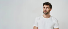 Young Bearded Man In White T-shirt Looking Up