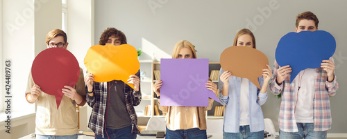 Fototapeta Your opinion matters. Make your voice heard. Group of young people holding multicolored empty cardboard and paper mockup speech bubbles covering their faces trying to get their message across obraz