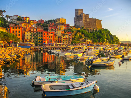 Fototapeta Lerici , Italy- June 5, 2010: Boats of Lerici docked in Lerici port and famous Italian Gulf of Poets