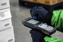 Bluetooth Barcode Scanner Checking Goods In The Cold Room Or Warehouse. Selection Focus Shooting On Bluetooth Barcode Scanner.
