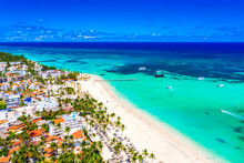 Beach Vacation And Travel Background. Aerial Drone View Of Beautiful Atlantic Tropical Beach With Straw Umbrellas, Palms, Boats And Pirate Ship. Bavaro Beach, Punta Cana, Dominican Republic.