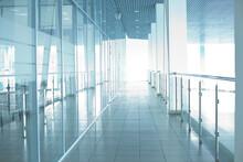 Image Of Big Windows Passing Daylight Inside Office Building. Sunny On Modern Glass Windows Building Interior Corridor