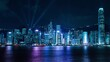 Light show and Hong Kong skyline at night near Victoria Harbour