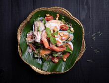 Spicy Sea Food (boiled Shrimp ,mussels And Squid) Is Mixed With Fresh Vegetable And Spicy Sauce, Thai Food Style.