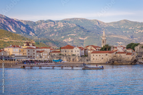 Photo Old town of Budva town on Adriatic shore, view with St John casthedral, Monteneg