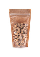 Pistachios In A Brown Paper Bag. Doy-pack With A Plastic Window For Bulk Products. Close-up. White Background. Isolated.