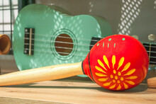 Red Maracas And Green Small Ukulele Guitar Sale In Music Shop