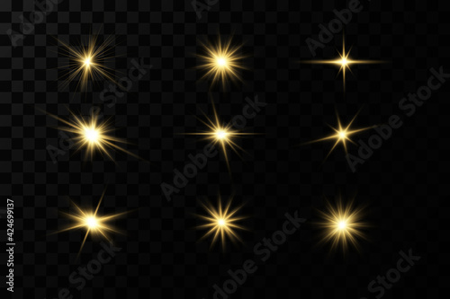 Fototapeta Shining golden stars isolated on black background. Effects, glare, lines, glitter, explosion, golden light. Vector illustration.Set.  obraz