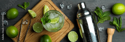 Papel de parede Glass of mojito cocktail, ingredients and shaker on dark wooden background