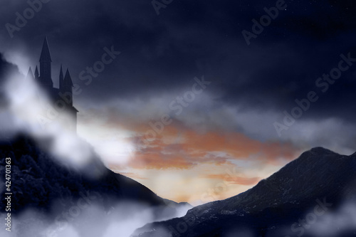 Fototapeta Fantasy world. Mystical castle and mountains covering with fog in night obraz