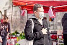 Masked Man Buys Lettuce Salad At Farmers Market