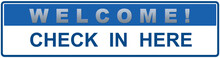 A Blue Sign That Says : WELCOME ! CHECK IN HERE