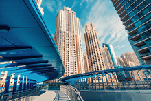 The Tallest Residential Block In The World - Jumeirah Beach Residence And Original Architecture Pedestrian Bridge In Dubai. Residential Real Estate And Development