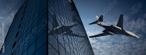 Fotografie, Obraz A modern fighter plane, flying low over a city with reflections on the skyscrape