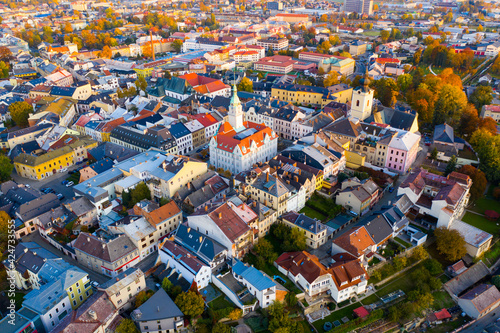 Leinwand Poster Panoramic aerial view of autumn landscape of Czech town of Sumperk with Church o