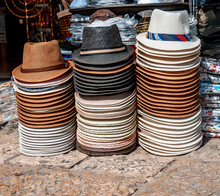 Men's Straw Hats In Three Columns For Sale In The Market