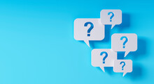 Question Mark Speech Bubbles In Front Of A Blue Wall - 3D Illustration