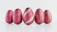 Easter Eggs Isolated Against A White Background. Chocolate Eggs Wrapped In Patterned Pink And Silver Foil. 3D Render