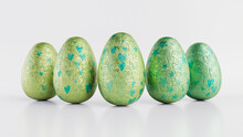 Easter Eggs Isolated Against A White Background. Chocolate Eggs Wrapped In Patterned Green And Aqua Foil. 3D Render