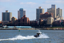 NYPD Boat  With Brooklyn Coastline On Background. Sunny Winter Day