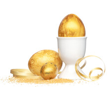 Easter Eggs In Egg Holder With Golden Ribbon And Dusting On White Background